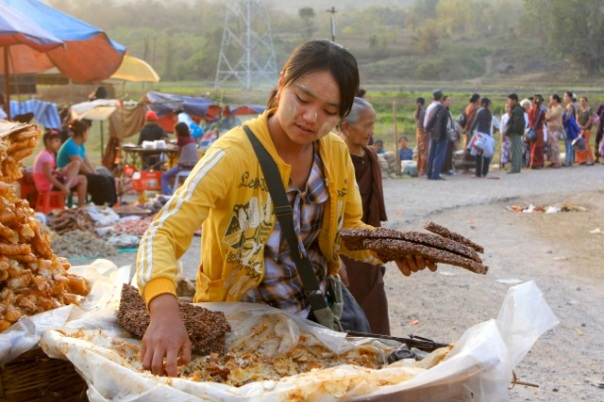 A street-food vendor on the outskirts of Hsipaw during the local pagoda festival. Northern Shan State, March 2012. Photo: Life in the Tropics